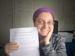 photo of daniella levy with contract from Kasva Press